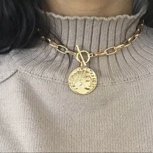 Gold Necklace with saint pendant